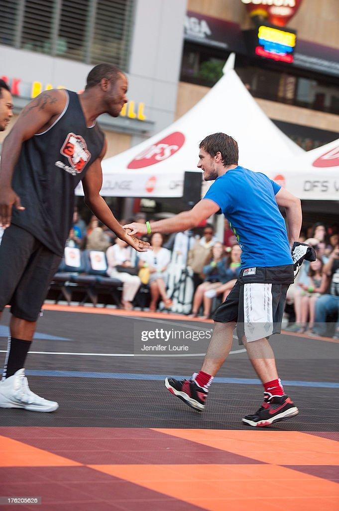 Actor Edwin Hodge (L) and Josh Hutcherson attend the 5th annual Nike basketball 3ON3 tournament presented by NBC4 southern california held at L.A. LIVE on August 9, 2013 in Los Angeles, California.