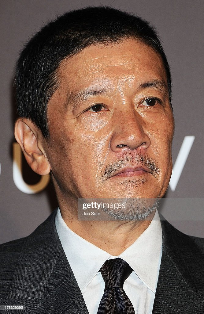 Actor Eiji Okuda attends Louis Vuitton 'Timeless Muses' exhibition at the Tokyo Station Hotel on August 29, 2013 in Tokyo, Japan.