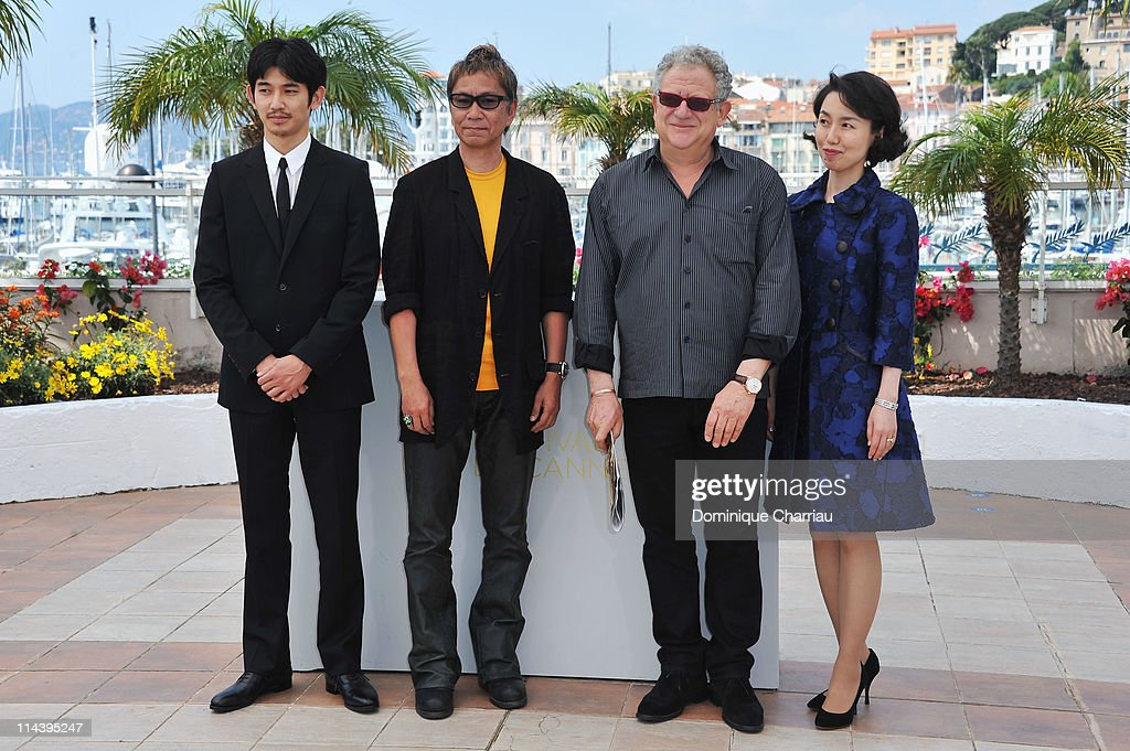 Actor Eita and director <a gi-track='captionPersonalityLinkClicked' href=/galleries/search?phrase=Takashi+Miike&family=editorial&specificpeople=822402 ng-click='$event.stopPropagation()'>Takashi Miike</a> with producer <a gi-track='captionPersonalityLinkClicked' href=/galleries/search?phrase=Jeremy+Thomas+-+Film+Producer&family=editorial&specificpeople=629756 ng-click='$event.stopPropagation()'>Jeremy Thomas</a> and screenwriter Kikumi Yamagishi attend the 'Ichimei' Photocall during the 64th Cannes Film Festival at the Palais des Festivals on May 19, 2011 in Cannes, France.