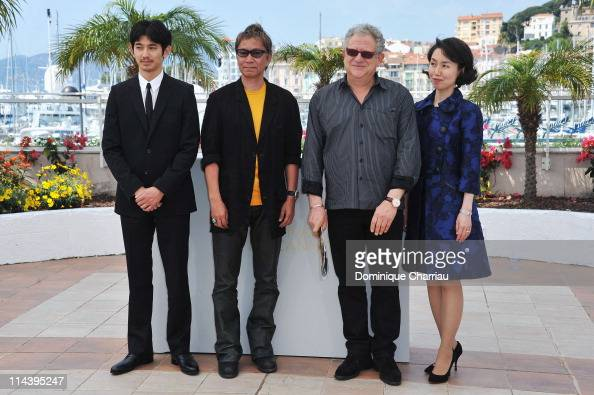 Actor Eita and director Takashi Miike with producer Jeremy Thomas and screenwriter Kikumi Yamagishi attend the 'Ichimei' Photocall during the 64th...