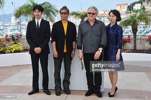 Actor Eita and director Takashi Miike with producer Jeremy Thomas and screenwriter Kikumi Yamagishi attend the 'Ichimei' Photocall during the 64th...
