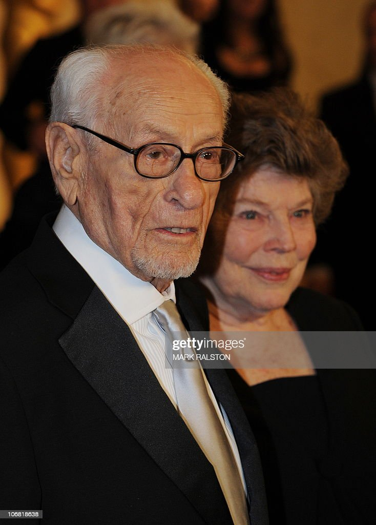 Actor Eli Wallach and guest arrives on the red carpet for the 2010 Oscars Governors Awards at the Hollywood and Highland Center in Hollywood on November 13, 2010. AFP PHOTO/Mark RALSTON