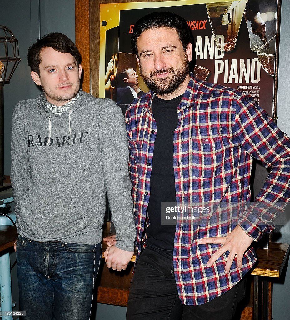 Actor Elijah Wood and director Eugenio Mira attend the 'Grand Piano' screening at Nitehawk Cinema on February 26 2014 in New York City