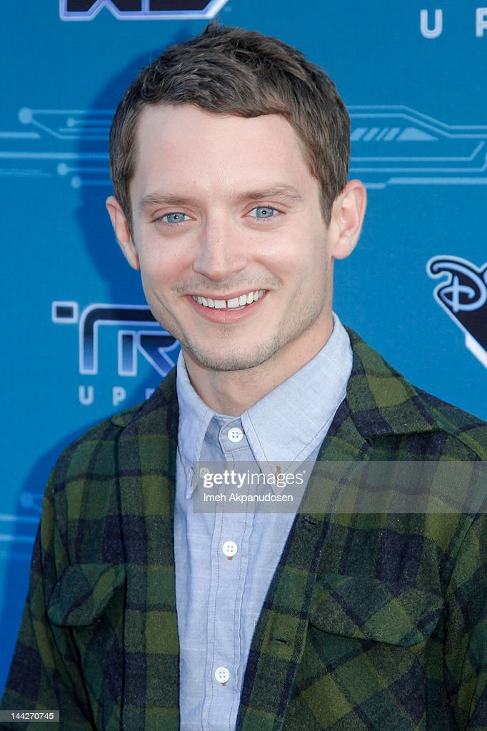Actor <a gi-track='captionPersonalityLinkClicked' href=/galleries/search?phrase=Elijah+Wood&family=editorial&specificpeople=171364 ng-click='$event.stopPropagation()'>Elijah Wood</a> attends Disney XD's 'TRON: Uprising' Press Event And Reception at DisneyToon Studios on May 12, 2012 in Glendale, California.