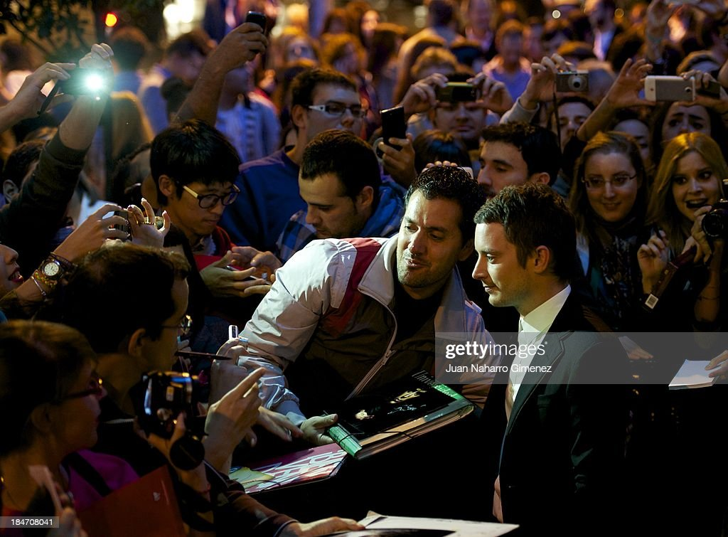 Actor <a gi-track='captionPersonalityLinkClicked' href=/galleries/search?phrase=Elijah+Wood&family=editorial&specificpeople=171364 ng-click='$event.stopPropagation()'>Elijah Wood</a> attends 'Grand Piano' premiere at the Capitol Cinema on October 15, 2013 in Madrid, Spain.