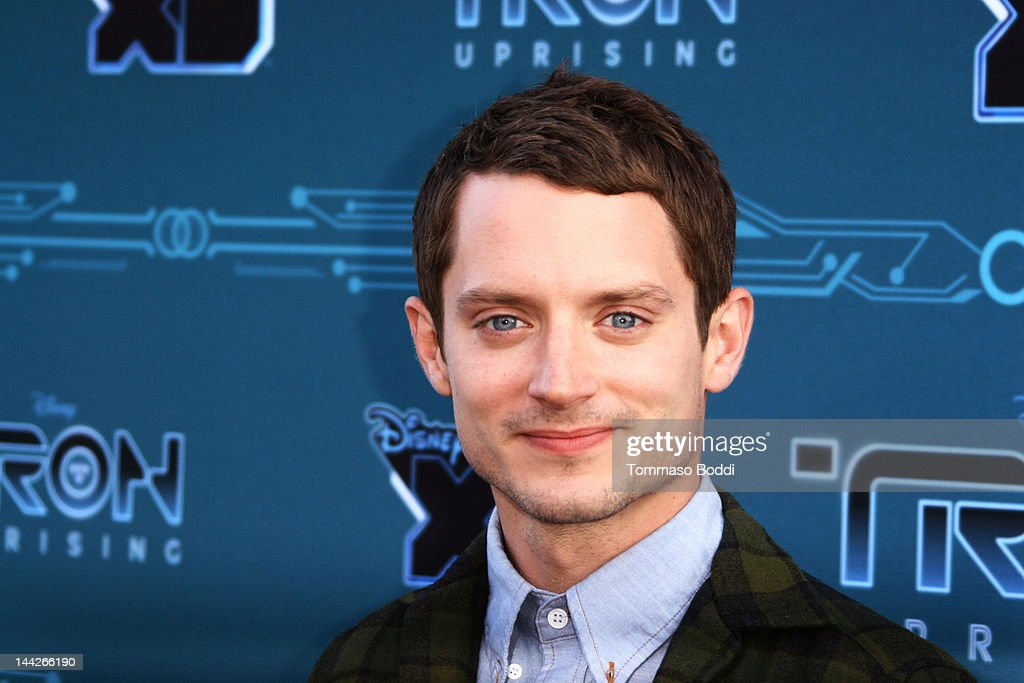 Actor <a gi-track='captionPersonalityLinkClicked' href=/galleries/search?phrase=Elijah+Wood&family=editorial&specificpeople=171364 ng-click='$event.stopPropagation()'>Elijah Wood</a> attends the Disney XD's 'TRON: Uprising' press event and reception held at the DisneyToon Studios on May 12, 2012 in Glendale, California.