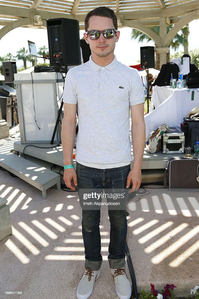 Actor <a gi-track='captionPersonalityLinkClicked' href=/galleries/search?phrase=Elijah+Wood&family=editorial&specificpeople=171364 ng-click='$event.stopPropagation()'>Elijah Wood</a> attends the FIJI Water At Lacoste L!VE Coachella Desert Pool Party on April 14, 2013 in Palm Springs, California.