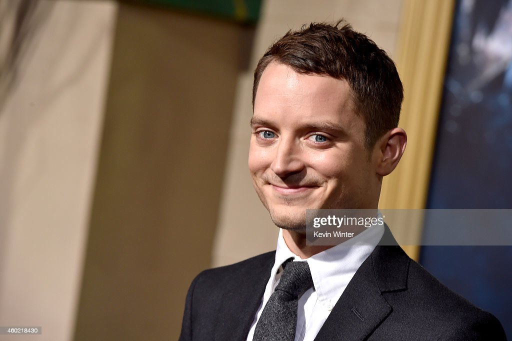Actor Elijah Wood attends the premiere of New Line Cinema MGM Pictures and Warner Bros Pictures' 'The Hobbit The Battle of the Five Armies' at Dolby...