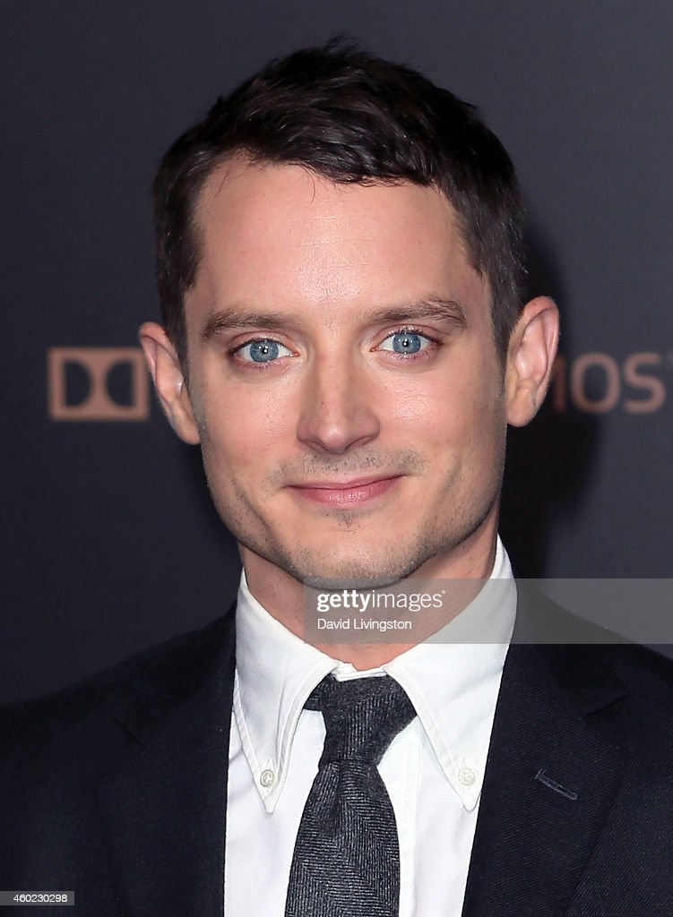 Actor Elijah Wood attends the premiere of New Line Cinema MGM Pictures and Warner Bros Pictures' 'The Hobbit The Battle of the Five Armies' at the...