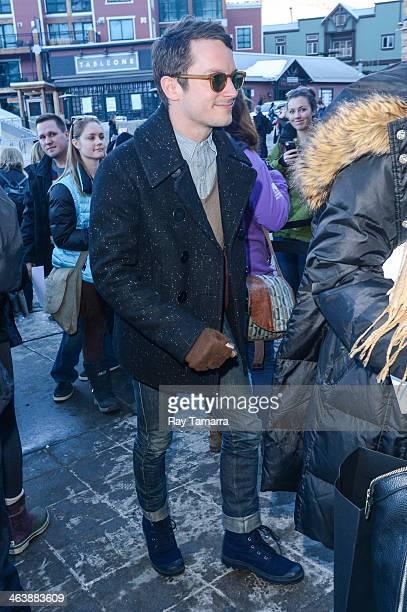 Actor Elijah Wood enters the Entertainment Weekly portrait studio on January 19 2014 in Park City Utah