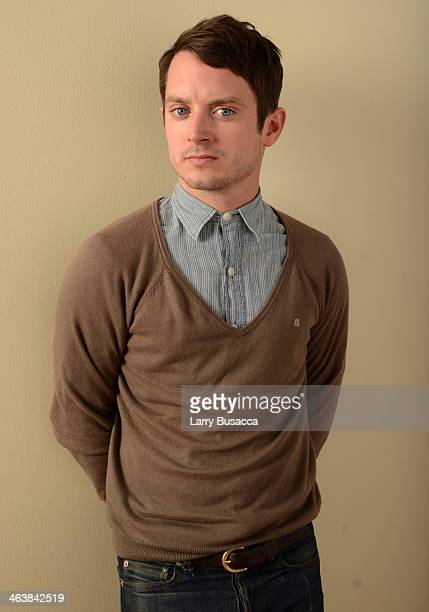 Actor Elijah Wood poses for a portrait during the 2014 Sundance Film Festival at the Getty Images Portrait Studio at the Village At The Lift...