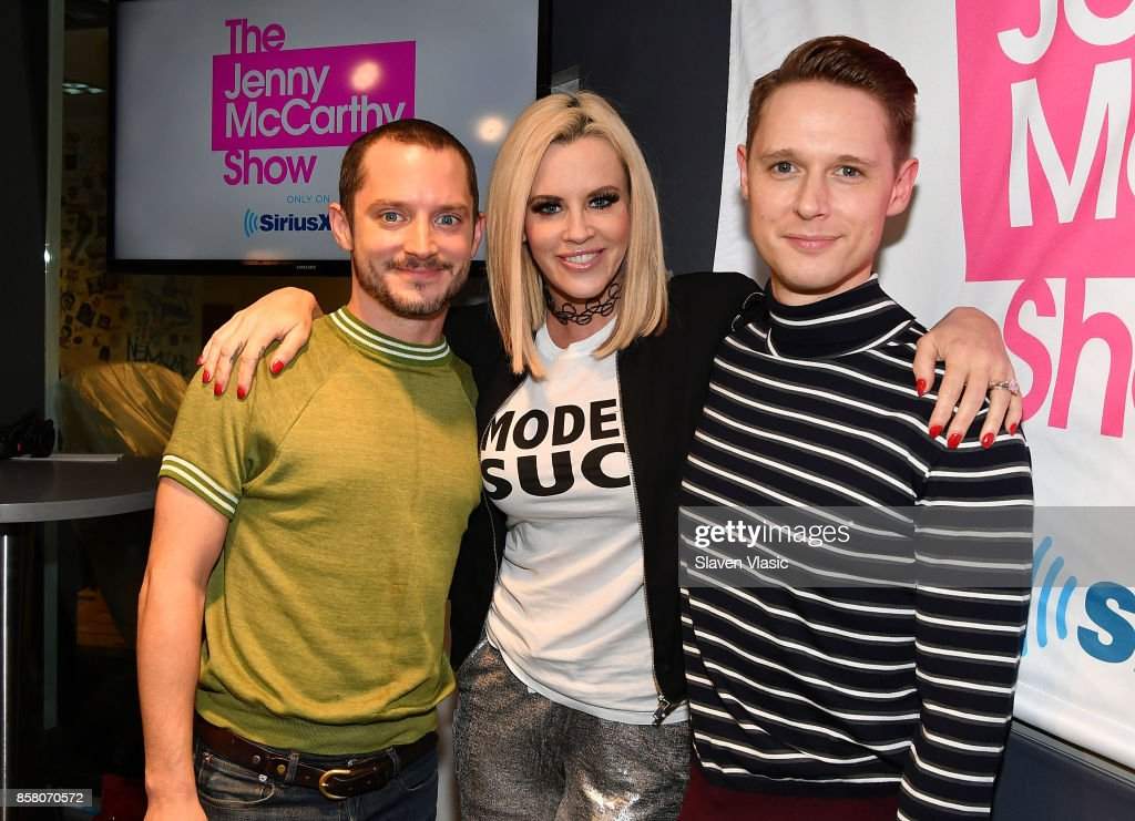Actor Elijah Wood, radio/TV personality Jenny McCarthy and actor Samuel Barnett pose for a photo at 'The Jenny McCarthy Show' at SiriusXM Studios on October 5, 2017 in New York City.