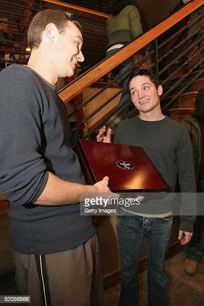 Actor Elijah Wood visits the Michelob Amber Bock World Poker Tour display at the Gibson Gift Lounge during the 2005 Sundance Film Festival on January...