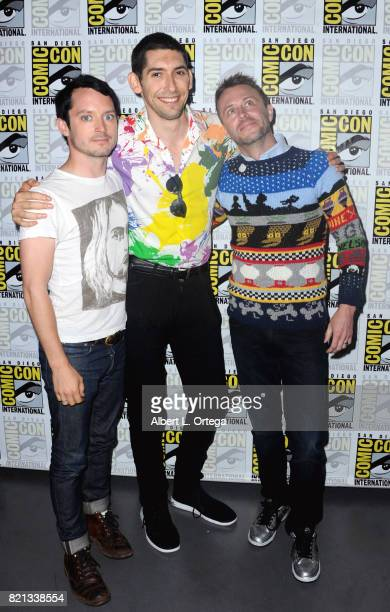 Actor Elijah Wood writer/producer Max Landis and Chris Hardwick pose at Dirk Gently's Holistic Detective Agency BBC America Official Panel during...