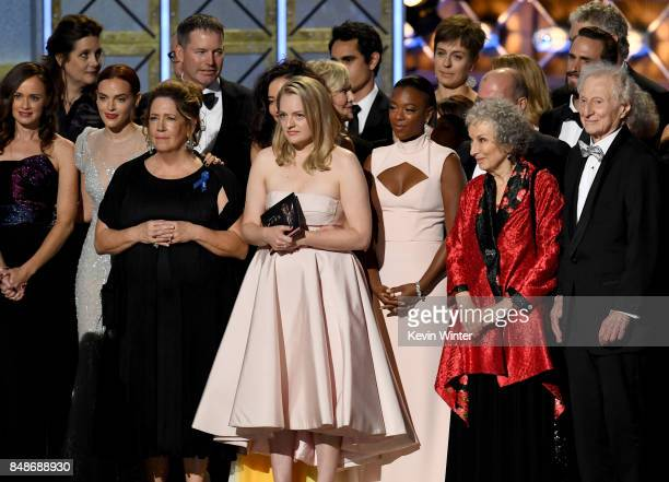 Actor Elisabeth Moss and author Margaret Atwood with cast and crew of 'The Handmaid's Tale' accept the Outstanding Drama Series award onstage during...