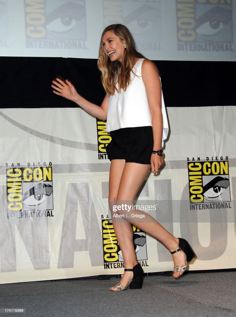 Actor <a gi-track='captionPersonalityLinkClicked' href=/galleries/search?phrase=Elizabeth+Olsen&family=editorial&specificpeople=5775031 ng-click='$event.stopPropagation()'>Elizabeth Olsen</a> speaks onstage at the Warner Bros. and Legendary Pictures preview of 'Godzilla' during Comic-Con International 2013 at San Diego Convention Center on July 20, 2013 in San Diego, California.