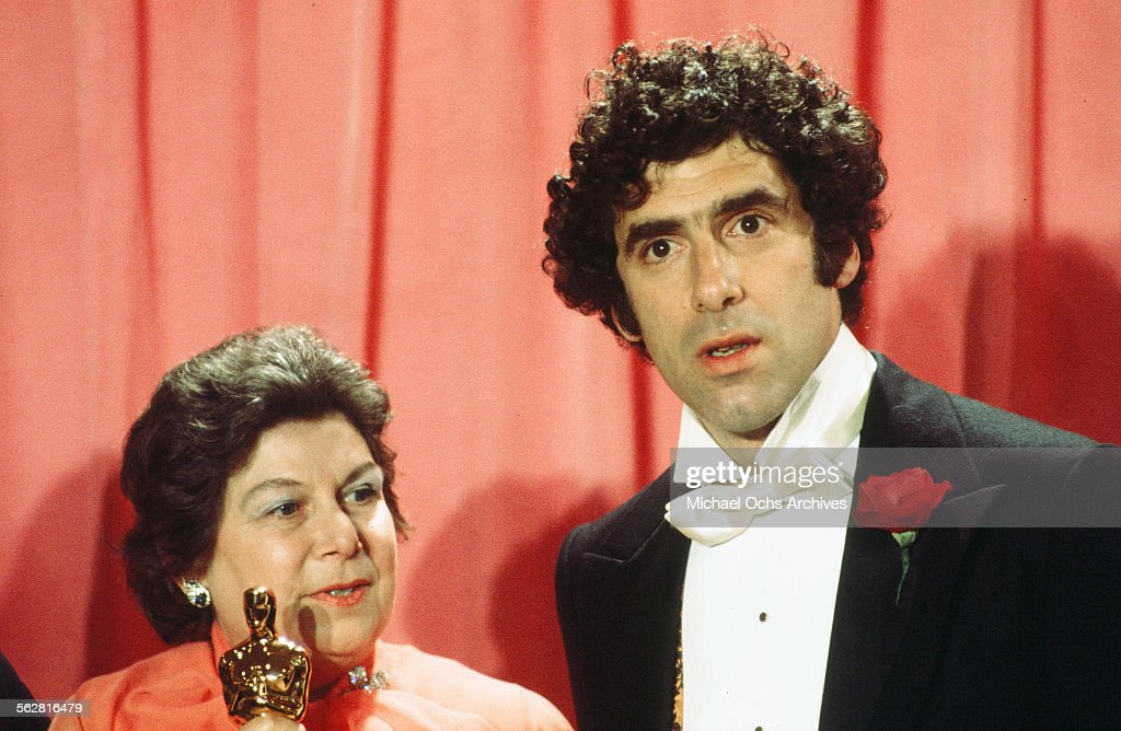 Actor Elliott Gould poses backstage with Verna Fields winner of ' Best Film Editing' award during the 48th Academy Awards at Dorothy Chandler...