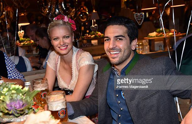 Actor Elyas M'Barek and Franziska Knuppe attend the Almauftrieb during the Oktoberfest 2015 at Kaefer Tent on September 20 2015 in Munich Germany