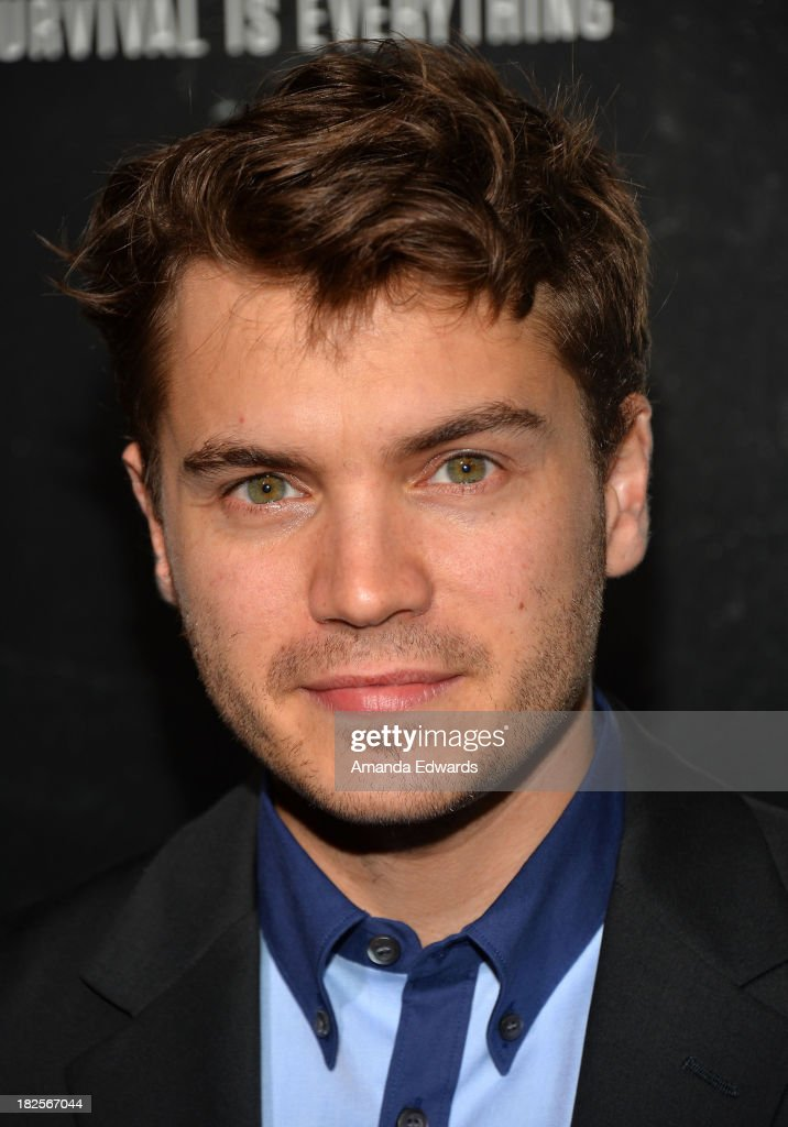 Actor <a gi-track='captionPersonalityLinkClicked' href=/galleries/search?phrase=Emile+Hirsch&family=editorial&specificpeople=210805 ng-click='$event.stopPropagation()'>Emile Hirsch</a> arrive at the Los Angeles premiere of 'Captain Phillips' at the Academy of Motion Picture Arts and Sciences on September 30, 2013 in Beverly Hills, California.