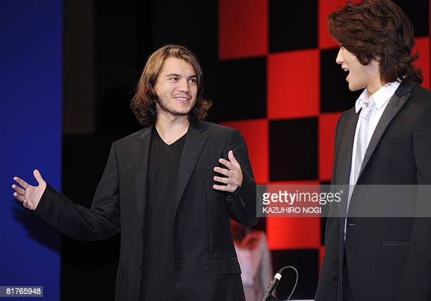 US actor Emile Hirsch as speed racer in the US film 'Speed Racer' speaks with Japanese actor Jin Akanishi who is dubbing in Japanese during a press...