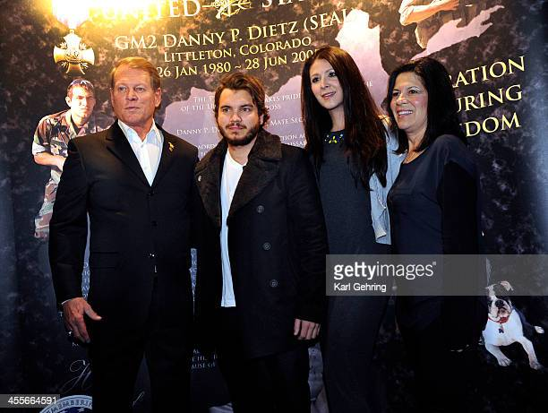 Actor Emile Hirsch center posed with the family of Danny Dietz Jr at a movie screening Thursday night December 12 2013 Hirsch portrays Danny in the...
