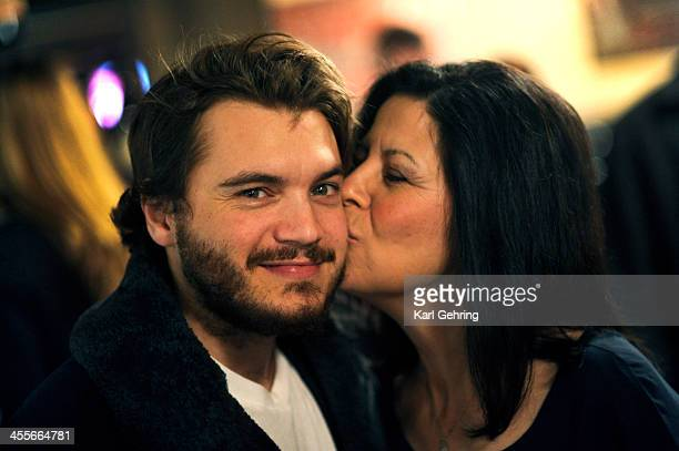 Actor Emile Hirsch left got a kiss on the cheek from Cindy DietzMarsh right at a movie screening Thursday night December 12 2013 Hirsch portrays her...