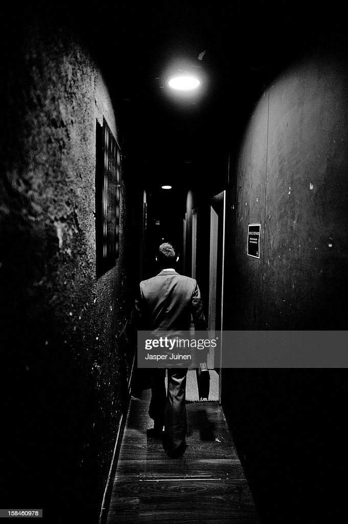 Actor Emilio Lorente walks to his room to perform with fellow actor Hector Gonzalez Nieto at the 'Micro Teatro por Dinero' on December 15, 2012 in Madrid, Spain. In November 2009, fifty artists presented a theatre project in the thirteen rooms of a former brothel, two weeks before its demolition, with each function lasting less than 10 minutes. The initiative was a huge success, with more people queueing up outside than could enter. Today's 'Micro Theatre For Money' is named after the former brothel on Ballesta Street, and offers a cheap and original way for going out at night, especially in times of financial hardship. With each show priced at 4 Euros, over 150,000 spectators have already attended performances at the tiny theatre in the Malasana area. Anyone can submit a project to be chosen to perform for a month in one of the five tiny rooms in the basement of the theatre, making it an ideal platform for young Spanish authors and actors, often unemployed, to perform.
