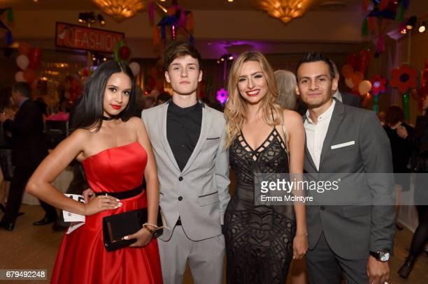 Actor Emily Tosta Influencers Crawford Collins and Kirsten Collins and Brandon Guerro attend the 24th Annual Race To Erase MS Gala at The Beverly...