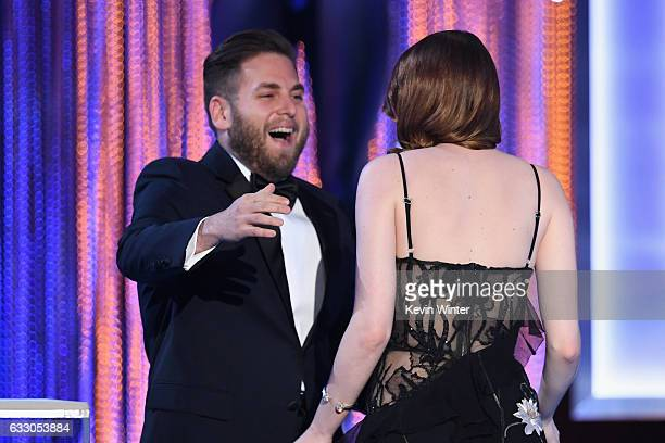 Actor Emma Stone accepts Outstanding Performance by a Female Actor in a Leading Role for 'La La Land' from actor Jonah Hill onstage during The 23rd...