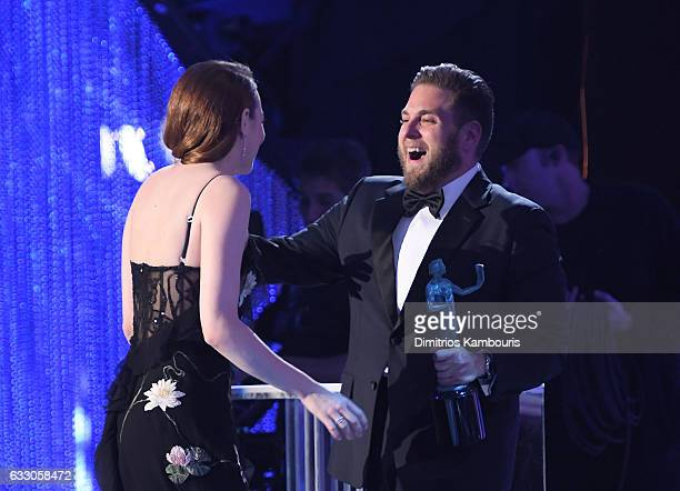 Actor Emma Stone accepts the award for 'A Female Actor in a Leading Role' from Jonah Hill onstage during The 23rd Annual Screen Actors Guild Awards...