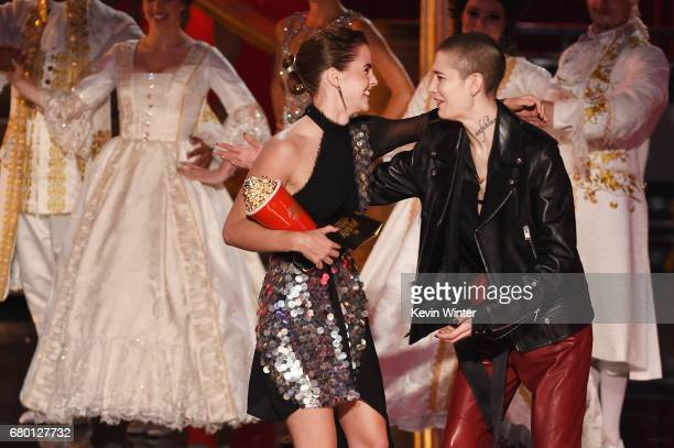 Actor Emma Watson accepts Best Actor in a Movie for 'Beauty and the Beast' from actor Asia Kate Dillon onstage during the 2017 MTV Movie And TV...