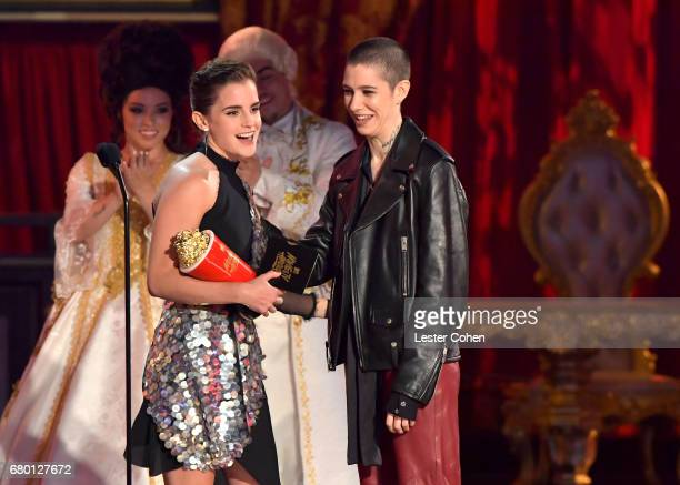 Actor Emma Watson accepts the award for Best Actor in a Movie from presenter Asia Kate Dillon onstage during the 2017 MTV Movie And TV Awards at The...