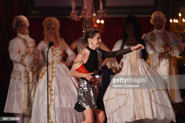 Actor Emma Watson accepts the award for Movie of the Year for 'Beauty and the Beast' onstage during the 2017 MTV Movie And TV Awards at The Shrine...