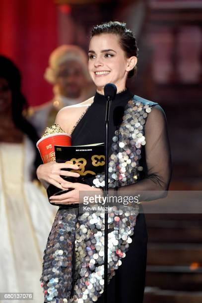 Actor Emma Watson accepts the Best Actor in a Movie award for 'Beauty and the Beast' onstage during the 2017 MTV Movie And TV Awards at The Shrine...