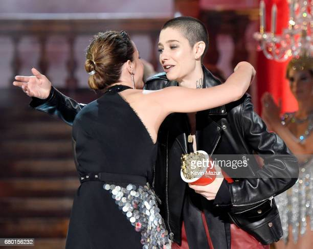 Actor Emma Watson accepts the Best Actor in a Movie award for 'Beauty and the Beast' from actor Asia Kate Dillon onstage during the 2017 MTV Movie...