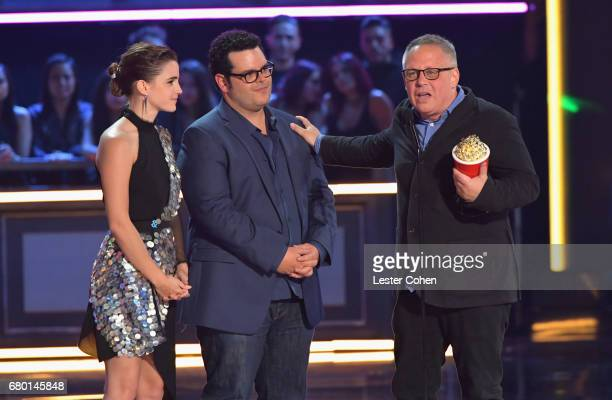 Actor Emma Watson actor Josh Gad and director Bill Condon accept the Movie of the Year award onstage during the 2017 MTV Movie And TV Awards at The...