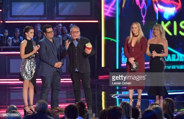 Actor Emma Watson actor Josh Gad and director Bill Condon accept the Movie of the Year award from presenters Amy Schumer and Goldie Hawn onstage...