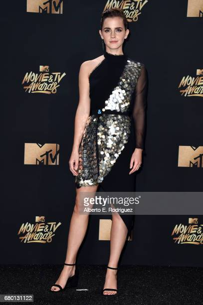 Actor Emma Watson winner of Best Actor in a Movie award for 'Beauty and the Beast' poses in the press room during the 2017 MTV Movie And TV Awards at...