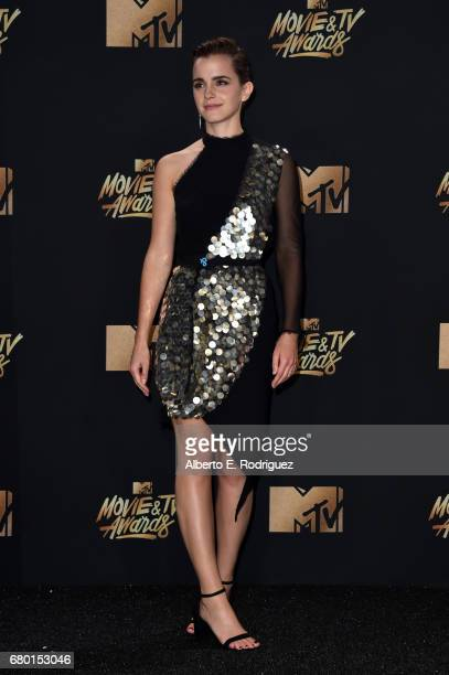 Actor Emma Watson winner of the Best Actor Award poses in the press room during the 2017 MTV Movie And TV Awards at The Shrine Auditorium on May 7...