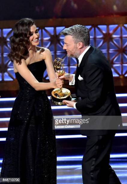 Actor Emmy Rossum presents writer Charlie Brooker the Outstanding Writing for a Limited Series Movie or Dramatic Special award for 'Black Mirror San...