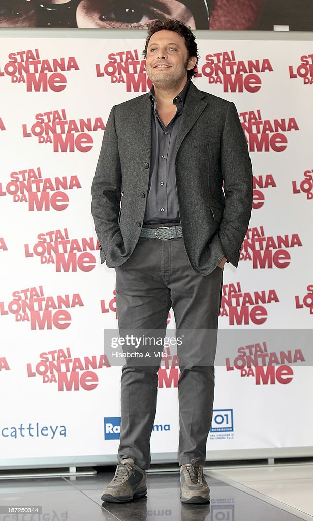 Actor <a gi-track='captionPersonalityLinkClicked' href=/galleries/search?phrase=Enrico+Brignano&family=editorial&specificpeople=676896 ng-click='$event.stopPropagation()'>Enrico Brignano</a> attends 'Stai Lontana Da me' photocall at Cinema Adriano on November 7, 2013 in Rome, Italy.