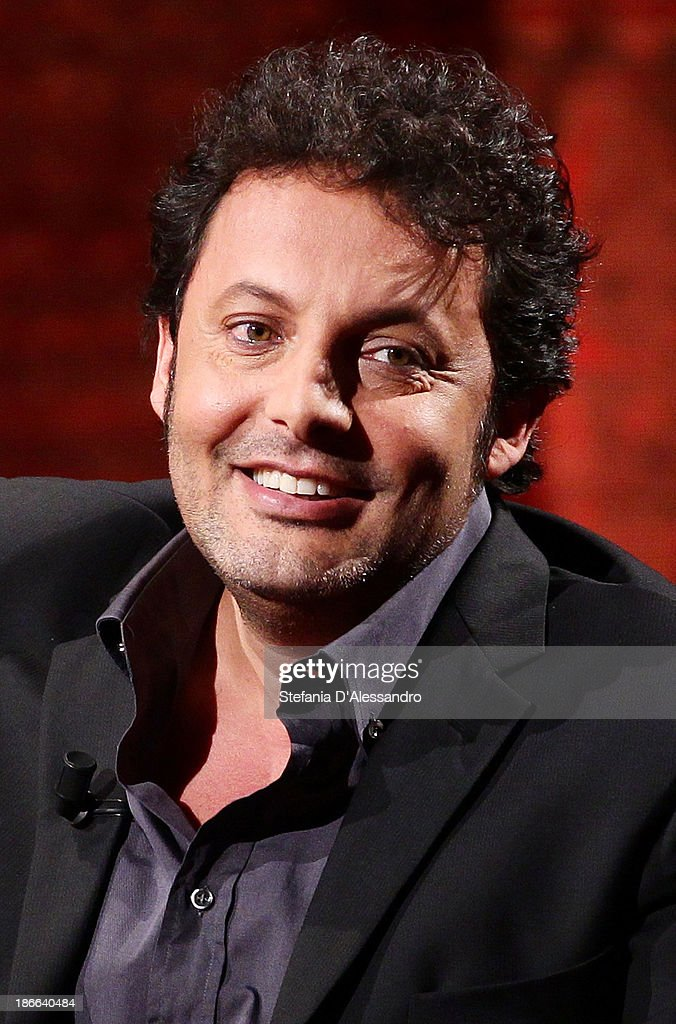 Actor <a gi-track='captionPersonalityLinkClicked' href=/galleries/search?phrase=Enrico+Brignano&family=editorial&specificpeople=676896 ng-click='$event.stopPropagation()'>Enrico Brignano</a> performs at 'Che Tempo Che Fa' TV Show on November 2, 2013 in Milan, Italy.
