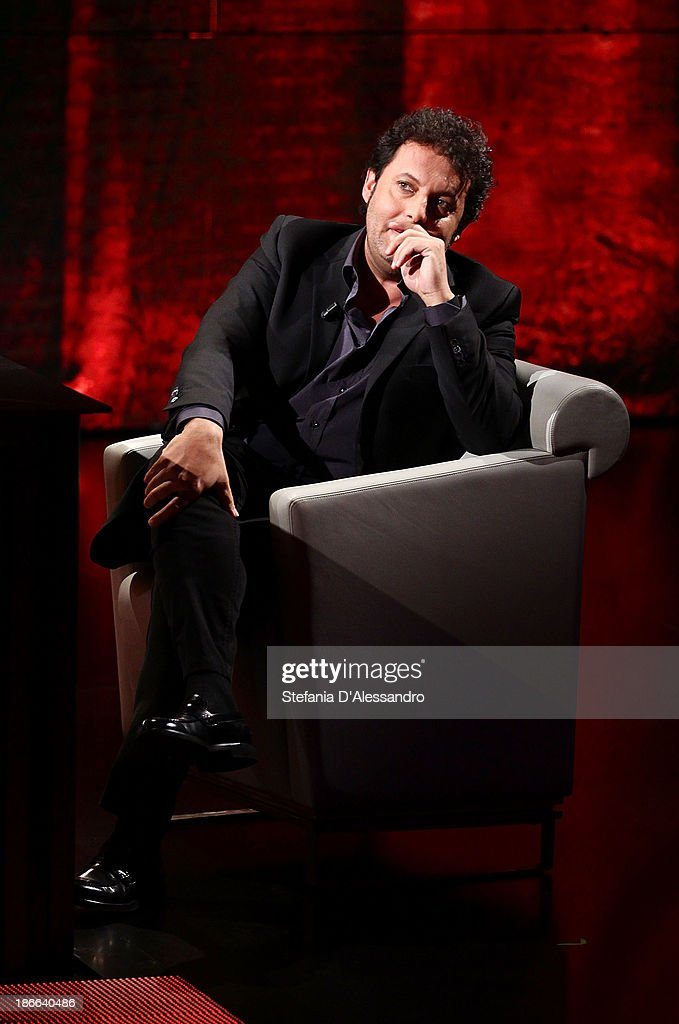 Actor Enrico Brignano performs at 'Che Tempo Che Fa' TV Show on November 2, 2013 in Milan, Italy.