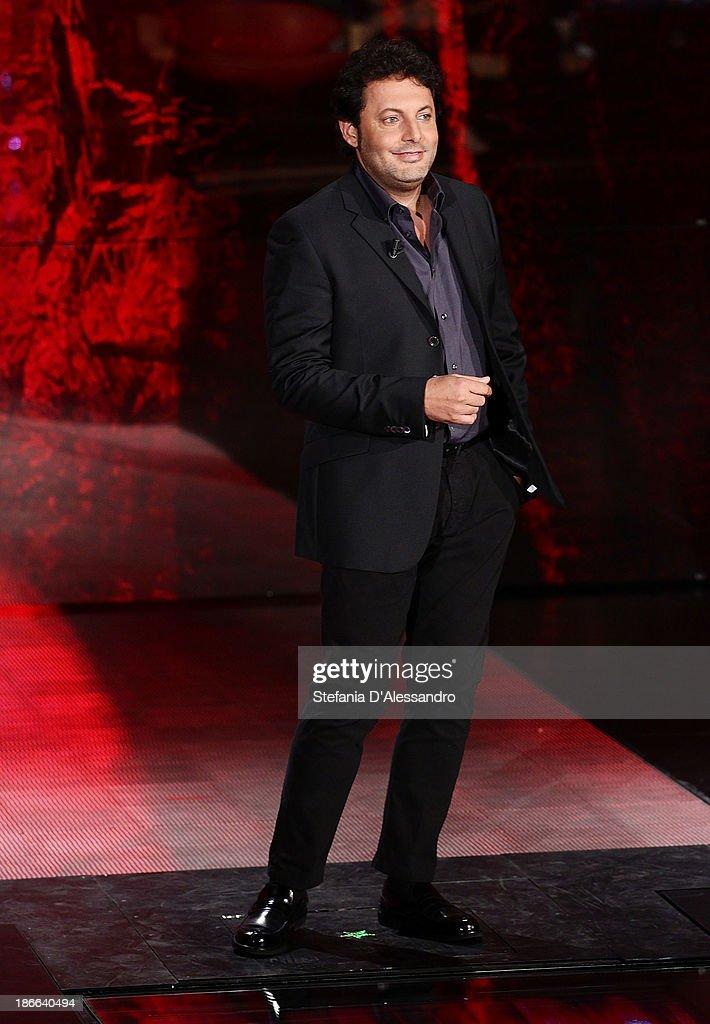 Actor Enrico Brignano performs at 'Che Tempo Che Fa' TV Show on November 2, 2013 in Milan, Italy.