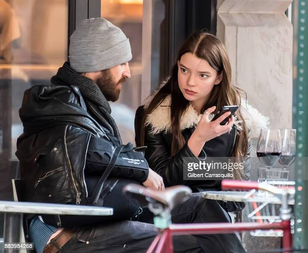Actor Eoin Macken and his fiancee actress Anya TaylorJoy are seen outside a restaurant on December 1 2017 in Philadelphia Pennsylvania