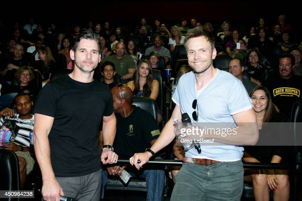 Actor Eric Bana and Joel McHale pose for a photo with law enforcement representatives from Arizona during a special screening of 'Deliver Us From...