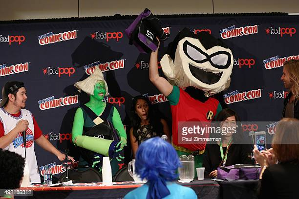 Actor Eric Bauza actress Shelby Rabara and animator Niki Yang greet costume contest winners onstage at the Cartoon Network Screening Steven Universe...