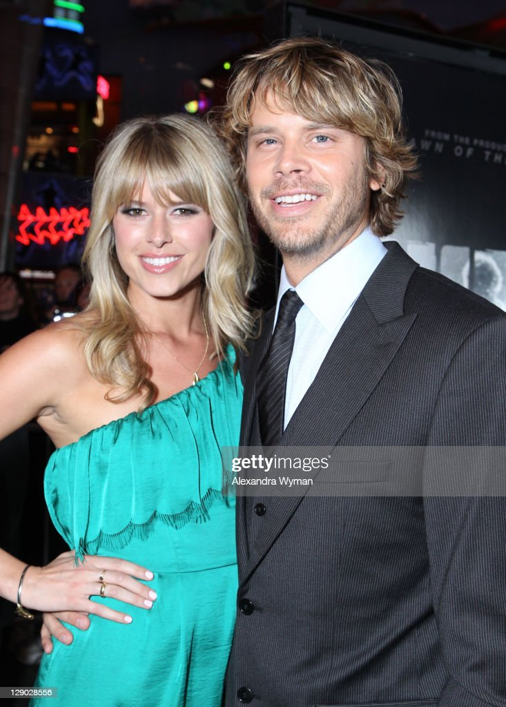 Actor Eric Christian Olsen and Sarah Wright arrive at 'The Thing' Los Angeles Premiere held at The AMC Universal City Walk on October 10 2011 in...