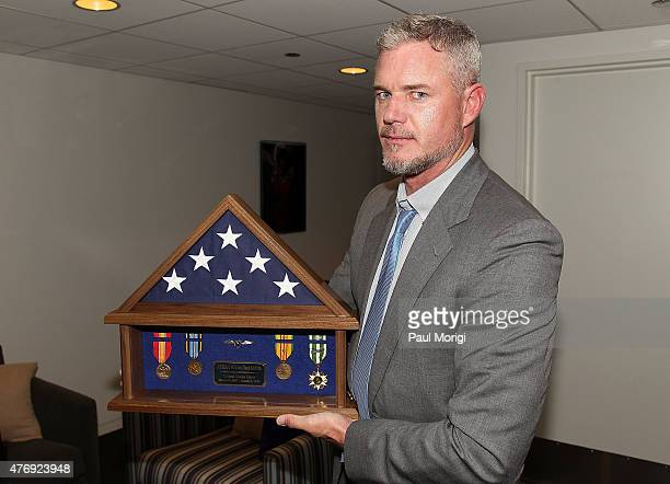 Actor Eric Dane shows a Shadow Box containing Navy medals earned by his father he was presented at the TNT 'The Last Ship' Washington DC Screening at...