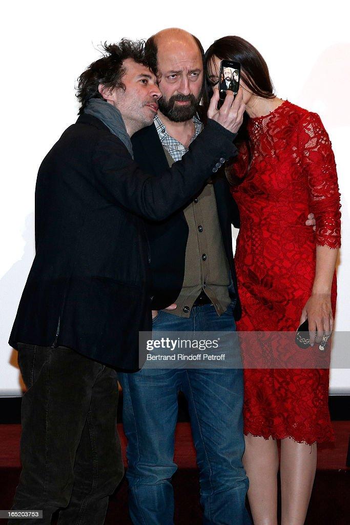 Actor Eric Elmosnino; Actor Kad Merad and Actress Monica Bellucci attend 'Des gens qui s'embrassent' movie premiere at Cinema Gaumont Marignan on April 1, 2013 in Paris, France.